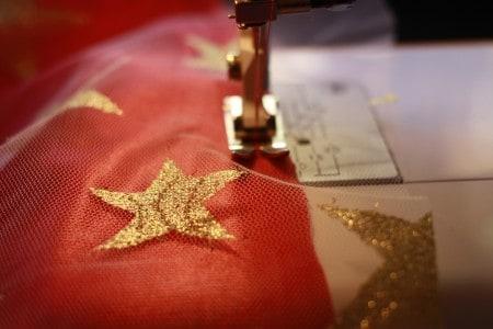 coser capa superheroe niña